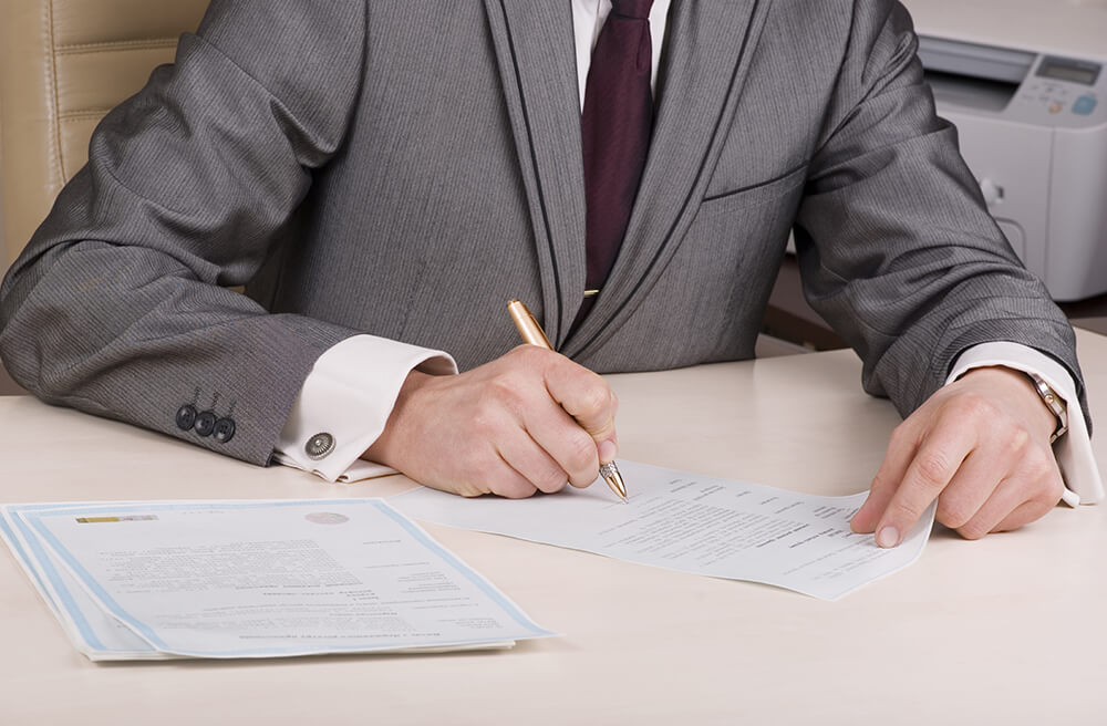Image of Business man filling out paperwork
