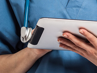 a medical professional working on a tablet device or ipad