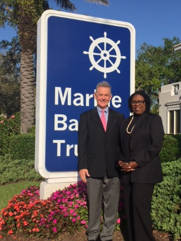 Marine Bank President and CEO Bill Penney with Indian River County Minority Scholarship Recipient Jonnie Mae Perry of Gifford Community Cultural & Resource Center in front of Marine Bank & Trust's Headquarters in Vero Beach.