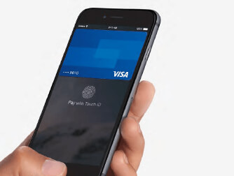 Someone holding up a smart phone that has an image of a visa credit card on the screen.